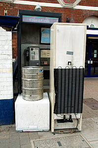 Fly tipping - old household appliances and other scrap metal suitable for recycling blocking the entrance to a public telephone box outside Drayton Park Station, Highbury, London Borough of Islington,...  -  Pat  Tuson