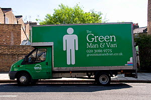 The Green Man and Van printed on side of green coloured van with Carbon Neutral on the door, London Borough of Hackney, England, UK, May 2013. - Pat  Tuson