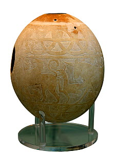 Decorated Ostrich egg dating to around 600 BC. Used as water container. Decorated with 4 sphinxes. Found in Isis tomb, an Etruscan tomb at Vulci, Italy. - David Tipling
