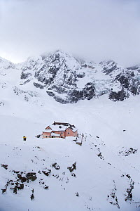 Hotel 'Refugio Citta di Milano' with Glacier of Il Gran Zebru (Konigspitze) on a very cold and cloudy winter day. Stevio National Park, Solda, Sulden am Ortler, Sudtirol, Italy. January 2013.  -  David  Pattyn