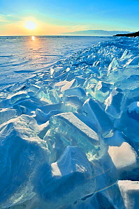 Ice pile of broken shelf ice, near the shore of Lake Baikal, Siberia, Russia, March. - Olga Kamenskaya