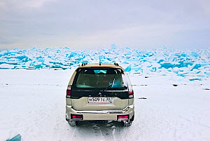 Car on thick Lake Baikal ice, Lake Baikal, Siberia, Russia, March. Property released. - Olga Kamenskaya