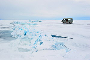 Mini van crossing Lake Baikal ice, Siberia, Russia, March.  -  Olga Kamenskaya