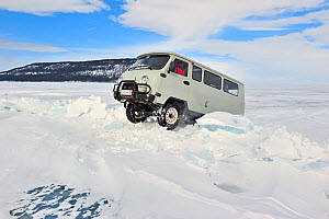 Mini van crossing over pile of ice on Lake Baikal,  Siberia, Russia, March. - Olga Kamenskaya