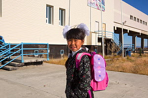 Nadia Takui, girl aged 9 years from a Chukchi reindeer herding family, dressed up for the first day of the new school year  at Amguema. Iultinsky District, Chukotka, Siberia, Russia, September 2013.  -  Bryan and Cherry Alexander
