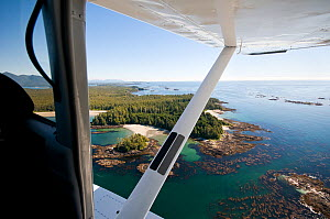 Aerial view out of float plane, of the Vancouver Island  coastline, Vancouver Island, British Columbia, Canada, July.  -  Bertie Gregory