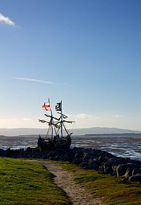 View of shipwreck of 'pirate ship' 'Grace Darling'. The ship was created and built on the rocks near the Hoylake lifeboat station. The ship is constructed mostly of driftwood and rubbish washed up on... - Norma  Brazendale