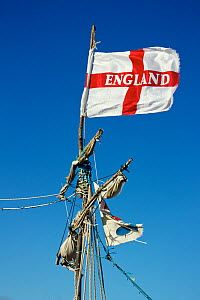 """England Flag tied to the mast of shipwreck of """"pirate ship"""" GRACE DARLING. The ship was created and  built on the rocks near the Hoylake lifeboat station. The ship is constructed mostly of driftwood a... - Norma  Brazendale"""