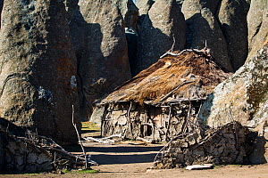 Hut in amongst the granite formations of Rafu. Bale Mountains National Park, Ethiopia, December 2011. - Will Burrard-Lucas