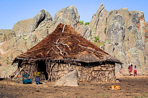Hut and local Oromo family at Rafu. Bale Mountains National Park, Ethiopia, December 2011. - Will Burrard-Lucas