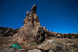 Photographer's tent under the stars and granite cliffs of Rafu. Bale Mountains National Park, Ethiopia, December 2011.  -  Will Burrard-Lucas