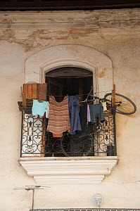 Laundry and a bicycle on an apartment balcony, Havana, Cuba, October 2011.  -  RHONDA KLEVANSKY