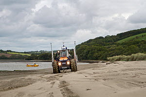 Tractor for towing the Cardigan volunteer lifeboat crew's new Atlantic 85 lifeboat, 'Albatross'. Poppit Sands, near Cardigan,  Pembrokeshire, Wales, United Kingdom, September 2013. - Graham  Brazendale