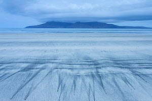 Patterns on beach and view to sea and the Isle of Rum, seen from Eigg, Scotland, May 2013. - Peter Cairns