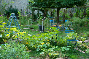Garden at Abbaye de Villelongue / Villelongue Abbey with recycled furniture, Montolieu, Aude, France, September 2013. - Jean E. Roche