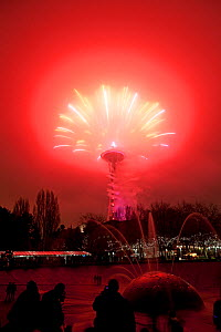 Space Needle with red sky during New Years firework display, Seattle, Washington, USA, 1st of January 2014.  -  Kirkendall-Spring