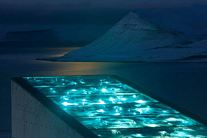 Svalbard Global Seed Vault, with glittering facade designed by artist Dyveke Sanne., on the roof of the Svalbard Global Seed Vault. Light reflected in steel, mirrors, and prisms in landscape, Svalbard...  -  Pal Hermansen