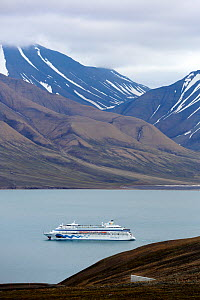 Ferry on Isfjorden with Svalbard Global Seed Vault visible in the corner of the landscape, Svalbard, Norway, July 2012.  -  Pal Hermansen