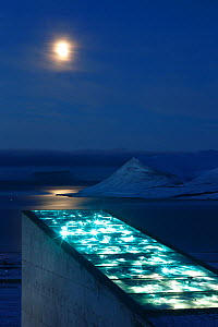 Moon and glittering facade designed by artist Dyveke Sanne, on the roof of the Svalbard Global Seed Vault. Light reflected in steel, mirrors, and prisms in landscape, Svalbard, Norway, October 2012  -  Pal Hermansen