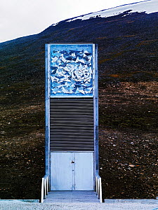 Svalbard Global Seed Vault entrance with glittering facade designed by artist Dyveke Sanne. Light reflected in steel, mirrors, and prisms in landscape, Svalbard, Norway, October 2012.  -  Pal Hermansen