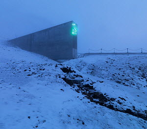 Svalbard Global Seed Vault in mist, with glittering facade designed by artist Dyveke Sanne. Light reflected in steel, mirrors, and prisms in landscape, Svalbard, Norway, October 2012.  -  Pal Hermansen