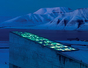 Svalbard Global Seed Vault at twilight, with glittering facade designed by artist Dyveke Sanne. Light reflected in steel, mirrors, and prisms in landscape, Svalbard, Norway, October 2012.  -  Pal Hermansen