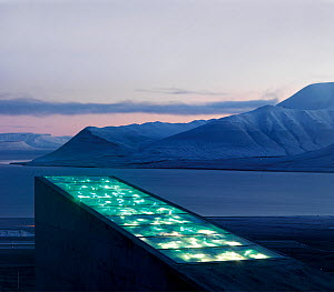 Svalbard Global Seed Vault, with glittering facade designed by artist Dyveke Sanne. Light reflected in steel, mirrors, and prisms in landscape, Svalbard, Norway, October 2012.  -  Pal Hermansen