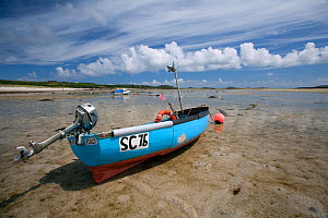Small motor boat on the beach at St Martin's, The Isles of Scilly  -  Sue Daly
