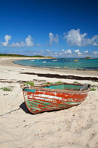 Old boat on beach at St Martin's, The Isles of Scilly, July 2013.  -  Sue Daly
