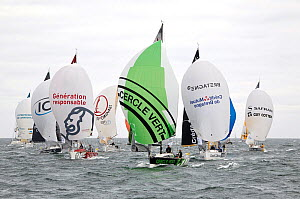 Figaro Beneteau mono-sail yacht fleet departing from Concarneau, with spinnakers up, during the Transat AG2R Transatlantic Race from Concarneau to St Barths. Corncarneau, France. 6th April 2014. All n... - Benoit  Stichelbaut