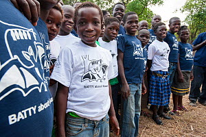 Local school children proudly wearing Kasanka Trust t-shirts on a visit to the National Park to see the mass aggregations of straw-coloured fruit bats (Eidolon helvum). Kasanka National Park, Zambia....  -  Nick Garbutt