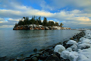 Ice covered rocks on shoreline of Lake Superior, view to Ellingson Island. Split Rock Lighthouse State Park, Minnesota, December 2011.  -  Thomas Lazar