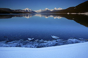 Lake McDonald in winter, snow capped peaks in the distance. Glacier National Park, Rocky Mountains, Montana, February 2008. - Thomas Lazar