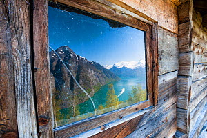Reflection of Geirangerfjorden and Sunnylvsfjorden in a window of a mountain hut at Blomberg (452m). More og Romsdal, Norway. May 2012  -  Orsolya  Haarberg