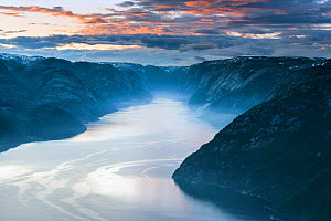 View over Lysefjorden from Preikestolen (Pulpit rock) at sunset, Forsand municipality, Rogaland, Norway. June 2012  -  Orsolya  Haarberg