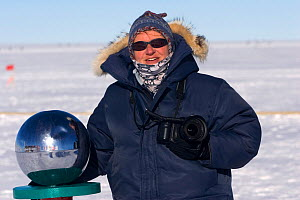 Photographer Cherry Alexander at the ceremonial South Pole, Antarctica.  -  Bryan and Cherry Alexander