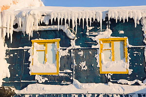 An old, snow covered wooden accommodation building in Sabetta, South Tambey Gas field, Yamal, Siberia, Russia. February 2014.  -  Bryan and Cherry Alexander