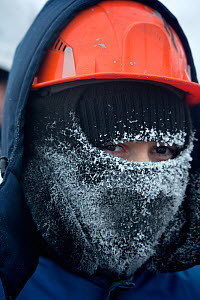 A gas field worker wearing protective clothing with frosted breath at -30 Celsius in the South Tambey Gas Field, Yamal Peninsula, Siberia, Russia. February 2014.  -  Bryan and Cherry Alexander