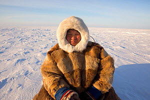 Jakov Vanuito, a Nenets reindeer herder, resting during a  snowmobile journey across the tundra in the South Tambey Gas Field, Yamal Peninsula, Siberia, Russia. February 2014.  -  Bryan and Cherry Alexander