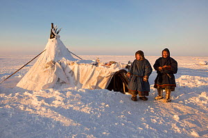 Grisha (right) and Gosha Vanuitto, Nenets reindeer herders, at their winter camp on the tundra in the South Tambey Gas Field, Yamal Peninsula, Siberia, Russia. February 2014. - Bryan and Cherry Alexander