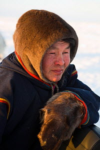 Nenets reindeer herder at winter camp on the tundra in the South Tambey Gas Field, Yamal Peninsula, Siberia, Russia. February 2014.  -  Bryan and Cherry Alexander