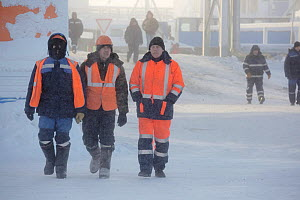 Gas field workers wearing winter clothing in Sabetta, South Tambey Gas Field, Yamal Peninsula, Siberia, Russia. February 2014.  -  Bryan and Cherry Alexander