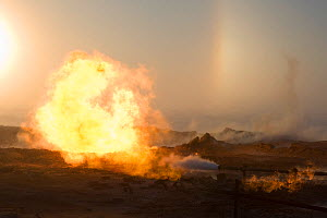 A gas flare at a drilling site in the South Tambey Gas Field, Yamal Peninsula, Siberia, Russia. February 2014.  -  Bryan and Cherry Alexander