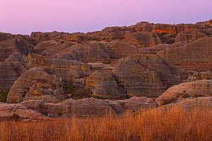 Isalo National Park before sunrise. Rock formation from Jurassic period, stones known as ruiniforms sculpted by wind and water, Isalo National Park, Madagascar. August 2013.  -  Ingo Arndt