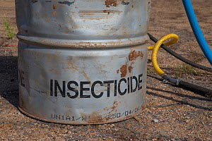 Barrel with insecticide for Food and Agriculture Organization (FAO) control action against migratory locust (Locusta migratoria capito), Airport Miandrivazo, Madagascar December 2013. - Ingo Arndt