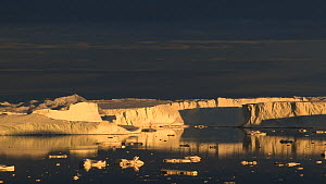 Time lapse of sunset light on a glacier, Antarctica.  -  Fred  Olivier