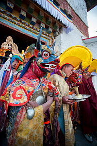 Monks and dancers walk in procession out of the monastery with the 'Cake' (containing all the evil) to be burned at the end of the first day of the Torgya festival. Galdan Namge Lhatse Monastery,Tawan... - Bernard Castelein
