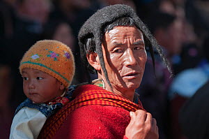 Man in traditional Monpa tribe dress (typical head dress made from Yak hair) during Torgya festival. Galdan Namge Lhatse Monastery,Tawang, Arunachal Pradesh, India. January 2014. - Bernard Castelein