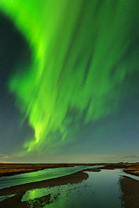 The Northern Lights / Aurora Borealis over a river, Vik, Iceland. February 2014. - Ross Hoddinott
