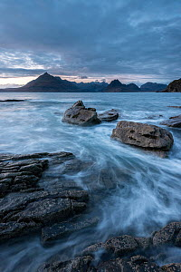 Waves washing up Elgol beach in the evening light with a view of the Cuillins, Strathaird peninsula, Isle of Skye, Scotland, UK. December 2013.  -  Ross Hoddinott